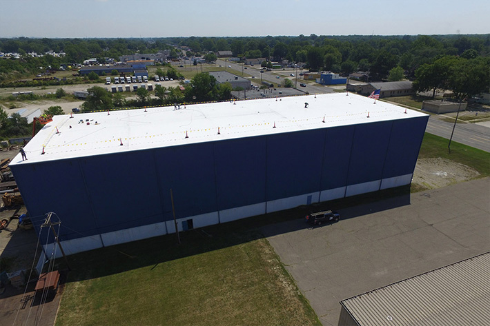 high-performance-roofing-system-benefits-MI-commercial-roof-installation